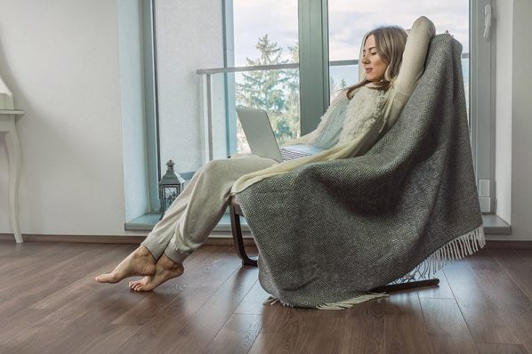 Woman relax on vintage sofa at home near the window. Interior decoration in living room